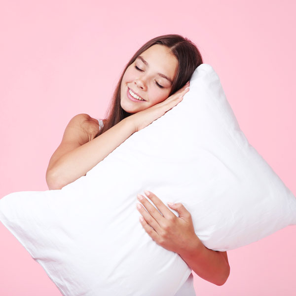young-girl-with-white-pillow